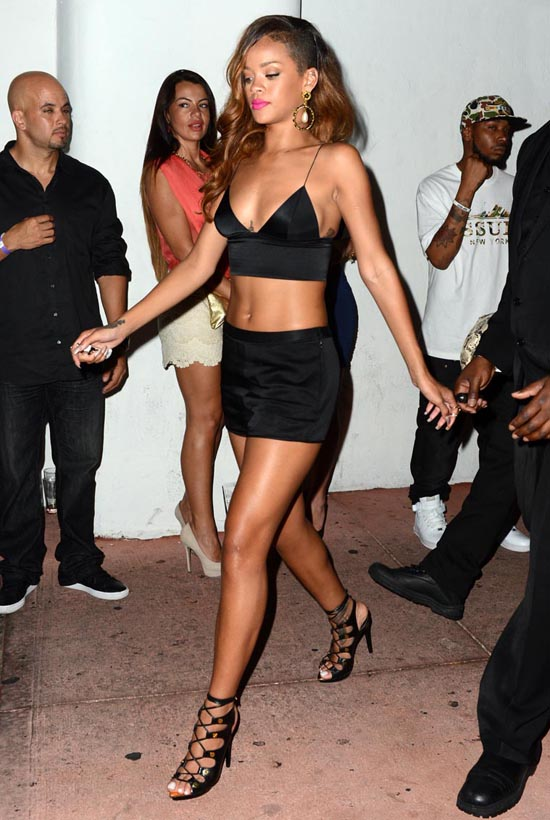 April 21, 2013: Rihanna is seen leaving Cameo nightclub holding hands with a girlfriend in Miami Beach, Florida. After her Diamonds World Tour concert at BankAtantic Center in Ft. Lauderdale, Rihanna parties with friends and crew at Cameo nightclub and then King of Diamonds strip club. Mandatory Credit: INFphoto.com Ref: infusmi-13|sp|